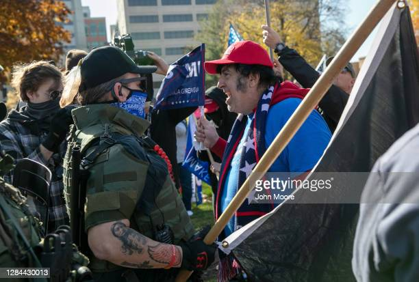 Trump supporter shouts down counter-protesters during a demonstration over election ballot counting outside the Michigan State Capitol building on...