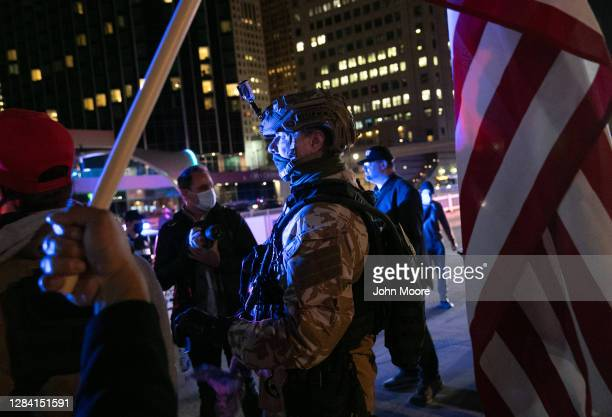 Trump supporter stands with fellow demonstrators after he was pepper sprayed by a counter protester outside the TCF election center November 05, 2020...