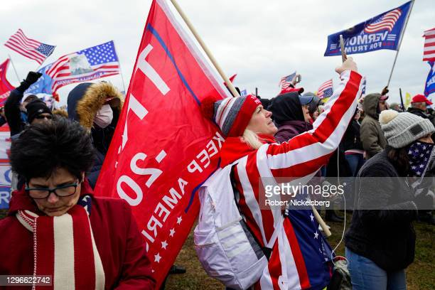 "Trump supporter takes a selfie with her iPhone as crowds gather for the ""Stop the Steal"" rally on January 06, 2021 in Washington, DC. Trump..."