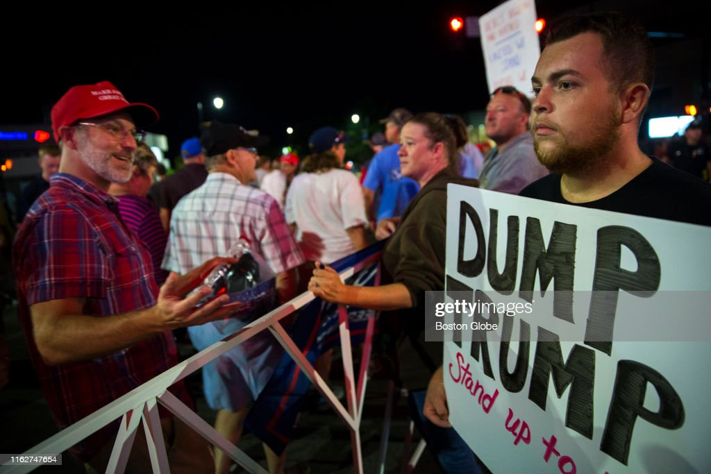 A Trump supporter taunts William Poole of Manchester, N H