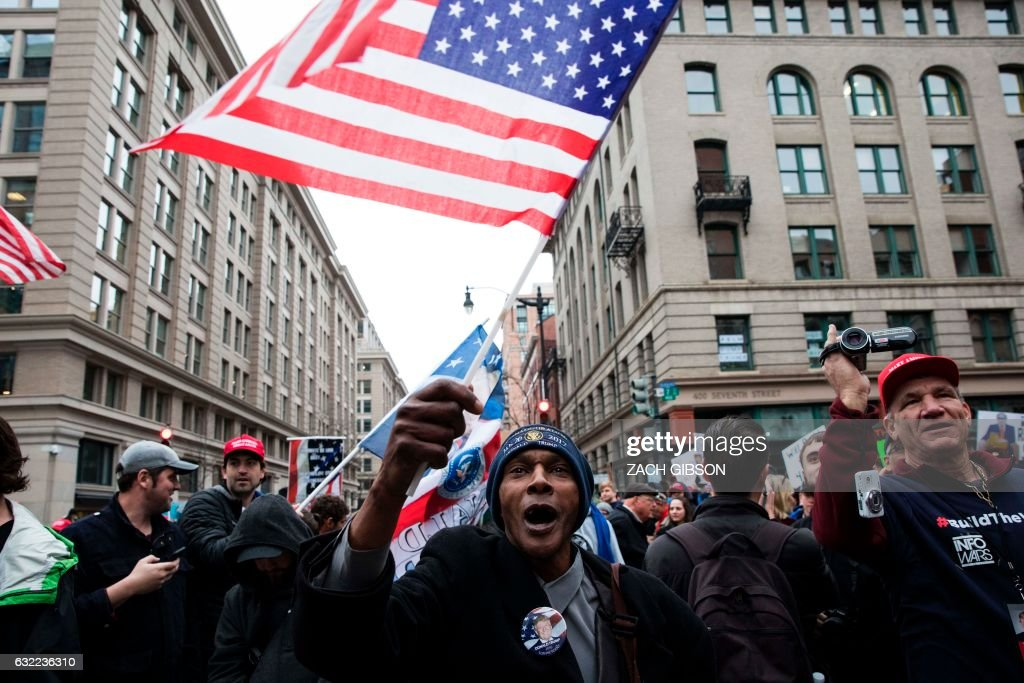 Trump supporter waves a flag before President Trump's inauguration on January 20, 2017 in Washington, DC. /