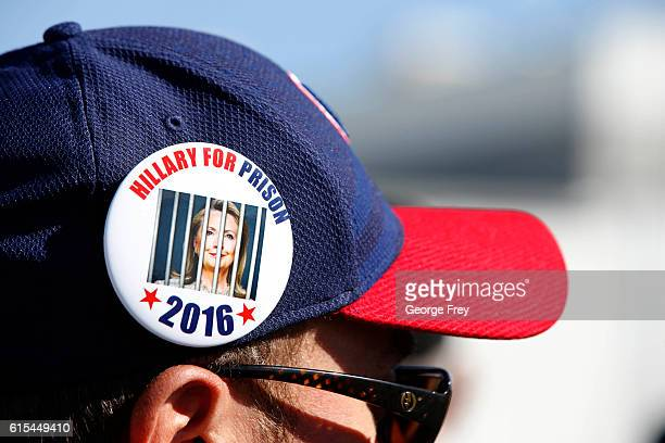 Trump supporter wears a Hillary for Prison button as he waits in line for a rally where Republican Presidential Candidate Donald Trump will speak on...