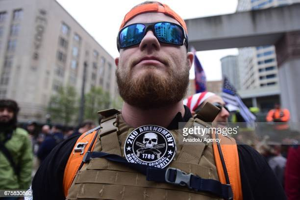 Trump supporter wears a second amendment patch during the Stand Against Communism rally at Westlake Park in Seattle Wash United States on May 1 2017