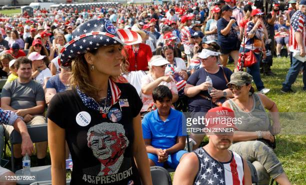 Trump supporter wears a Trump T-shirt and buttons at a Trump campaign-style rally in Wellington, Ohio, June 26, 2021. - Donald Trump held his first...