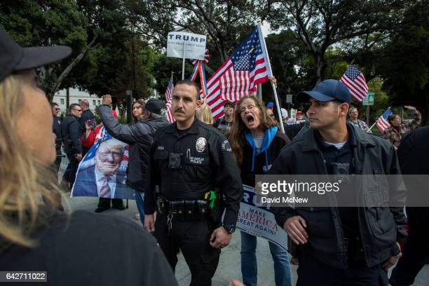 Trump supporter yells at a marcher during the Immigrants Make America Great March to protest actions being taken by the Trump administration on...