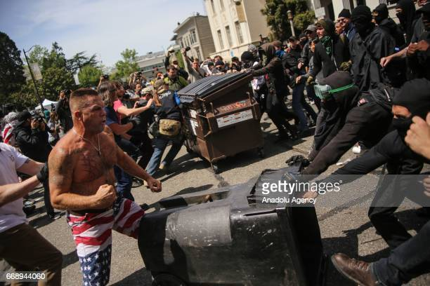 Trump supporter yells at AntiTrump Demonstrators during a proTrump rally in Berkeley USA on April 15 2017 A large number of fights have occurred and...