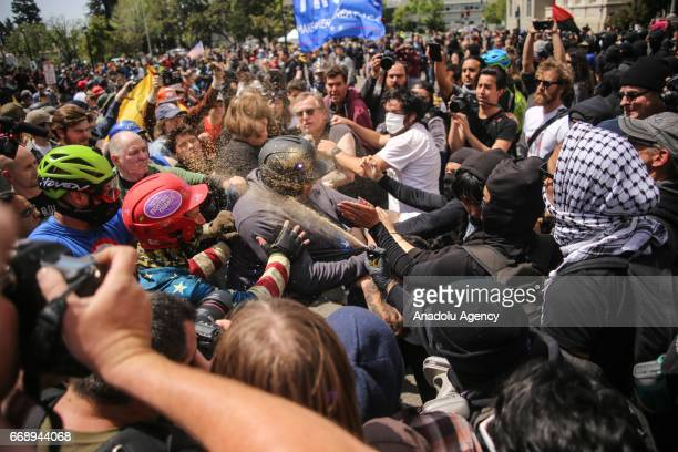 Trump supporters clash with antiTrump demonstrators during a proTrump rally in Berkeley USA on April 15 2017 A large number of fights have occurred...
