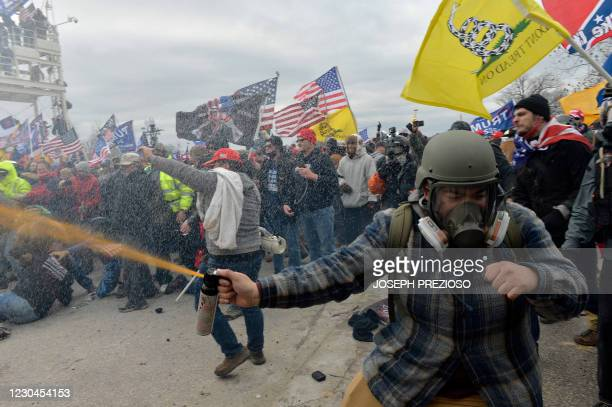 Trump supporters clash with police and security forces as people try to storm the US Capitol Building in Washington, DC, on January 6, 2021. -...