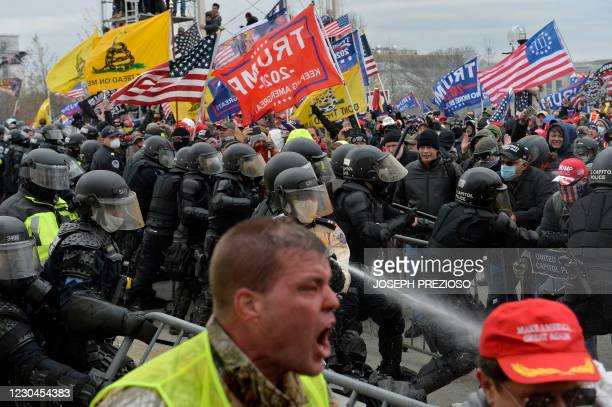 Trump supporters clash with police and security forces as people try to storm the US Capitol in Washington D.C on January 6, 2021. - Demonstrators...