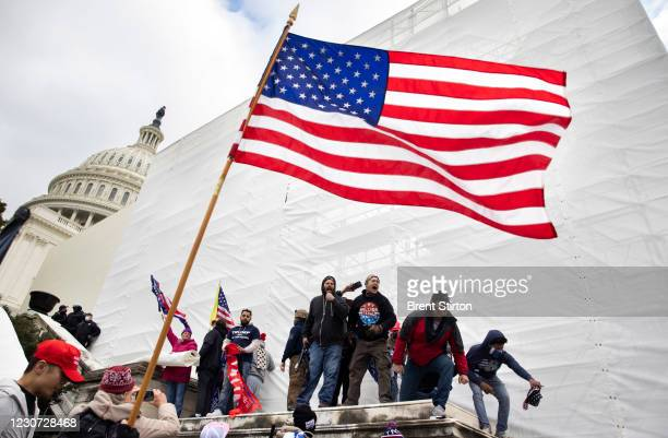 Trump supporters clash with police and security forces as people try to storm the US Capitol in Washington D.C on January 6, 2021. Demonstrators...