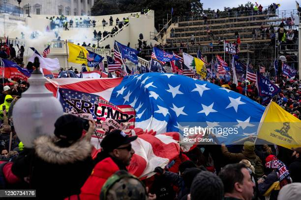 Trump supporters clash with police and security forces as people try to storm the US Capitol on January 6, 2021 in Washington, DC. Demonstrators...