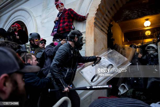 Trump supporters clash with police and security forces as people try to storm the US Capitol on January 6, 2021 in Washington, DC. - Demonstrators...