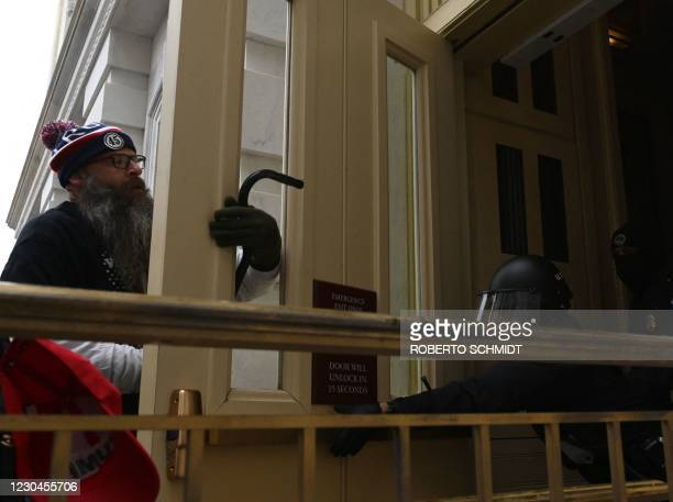 Trump supporters clash with police and security forces as they as they try to enter the US Capitol in Washington, DC on January 6, 2021. -...