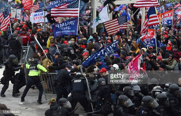 Trump supporters clash with police and security forces as they push barricades to storm the US Capitol in Washington D.C on January 6, 2021. -...