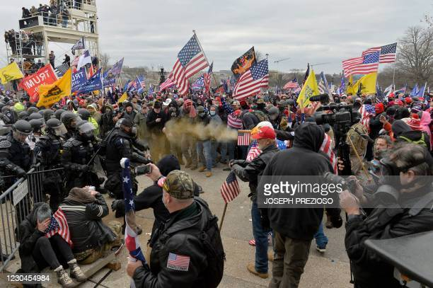 Trump supporters clash with police and security forces as they storm the US Capitol in Washington D.C on January 6, 2021. - Demonstrators breeched...