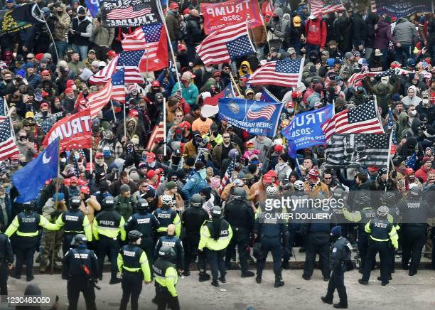 Trump supporters clash with police and security forces as they storm the US Capitol in Washington, DC on January 6, 2021. - Donald Trump's supporters...
