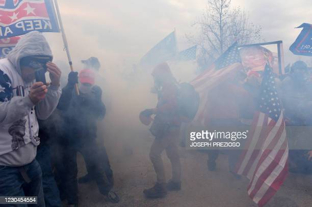 Trump supporters clash with police and security forces as they try to storm the US Capitol surrounded by tear gas in Washington, DC on January 6,...