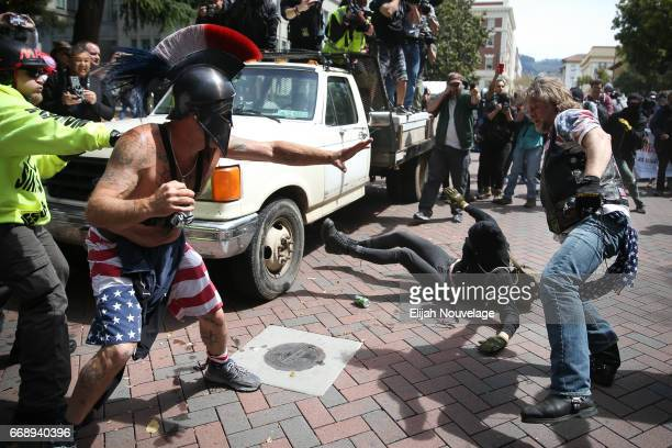 Trump supporters clash with protesters at a 'Patriots Day' free speech rally on April 15 2017 in Berkeley California More than a dozen people were...