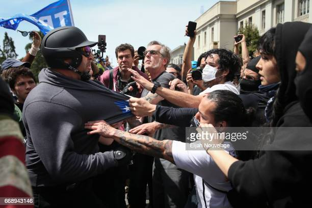 Trump supporters clash with protesters at a Patriots Day free speech rally on April 15 2017 in Berkeley California More than a dozen people were...