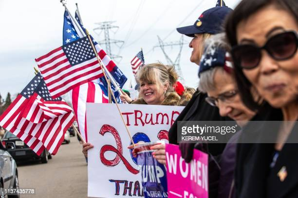 Trump supporters display US flags and signs as the Minnesota chapter of the Council on AmericanIslamic Relations and a coalition of community...
