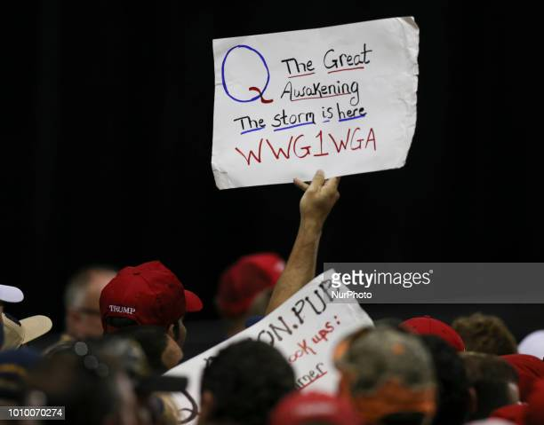 Trump supporters displaying QAnon posters appeared at President Donald J Trumps Make America Great Again rally Tuesday July 31 2018 at the Florida...