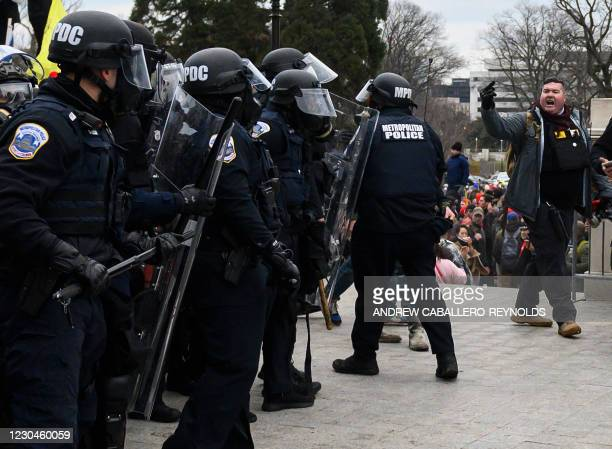 Trump supporters face off with police and security forces in front of the US Capitol in Washington DC on January 6, 2021. - Donald Trump's supporters...