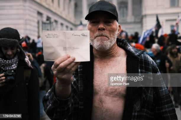 """Trump supporters gather outside the U.S. Capitol building following a """"Stop the Steal"""" rally on January 06, 2021 in Washington, DC. A pro-Trump mob..."""