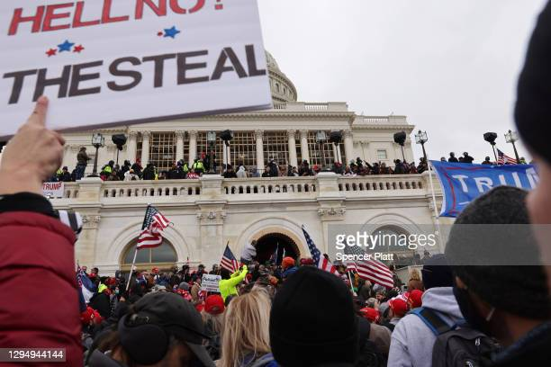 "Trump supporters gather outside the U.S. Capitol building following a ""Stop the Steal"" rally on January 06, 2021 in Washington, DC. A pro-Trump mob..."