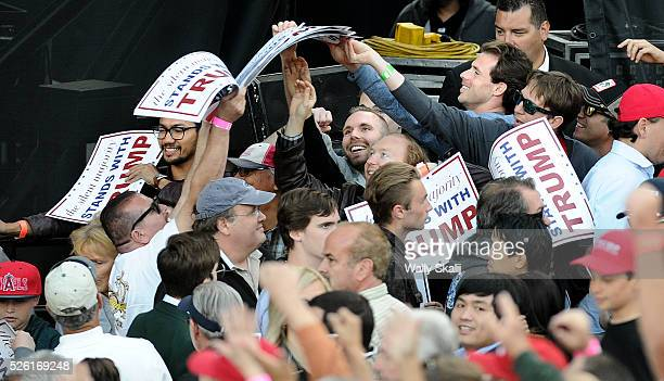 Trump supporters grab signs before a rally at the Orange County Fairgrounds in Costa Mesa Thursday, April 28, 2016.