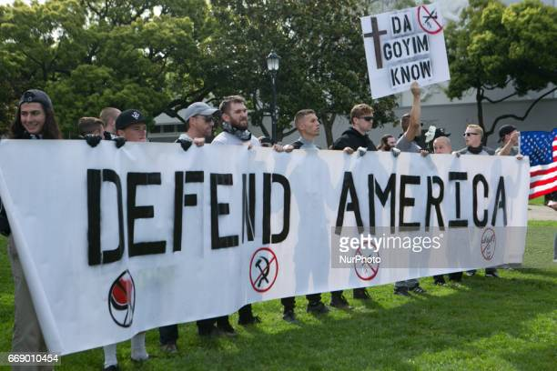 Trump supporters hold signs against antifascists during a free speech rally at Martin Luther King Jr Civic Center Park in Berkeley California United...