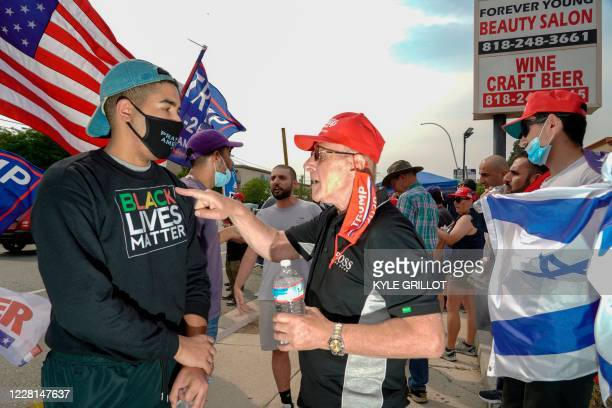 Trump supporters holding a rally, confront a counter-protestor wearing a BLM shirt in Tujunga, a north neighborhood of Los Angeles, California,...