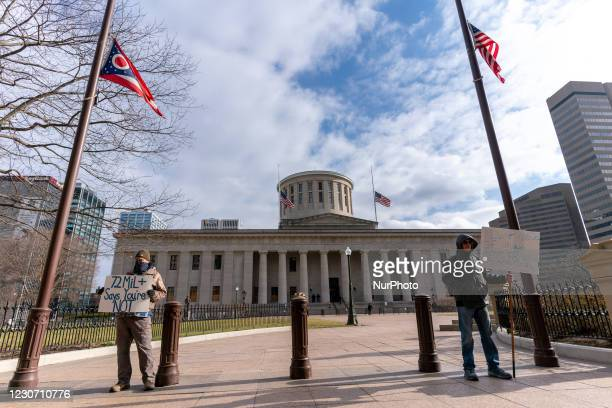 Trump supporters holdup signs as members of Antifa march from City Hall to the Ohio Statehouse after President Joe Biden was sworn into office in the...