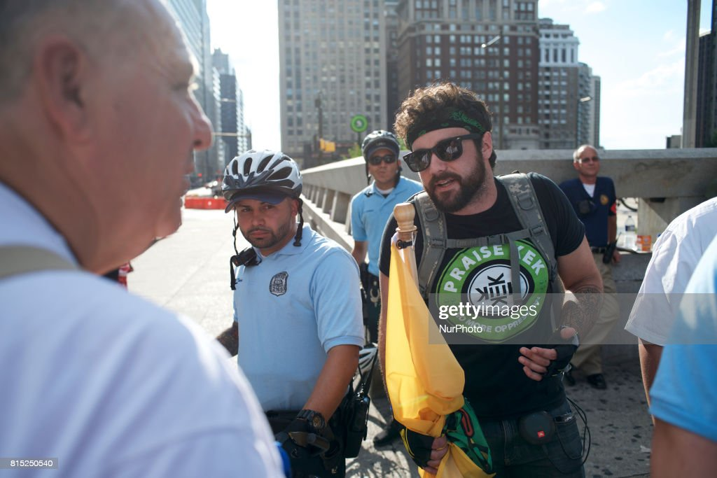 Trump supporters in a Kekistani shirt referring to a fictional country based on a meme is seen discussing with a protestor on the sidelines of a Anti-Trump Refuse Racism rally, in Center City Philadelphia, Pennsylvania, on July 15, 2017.