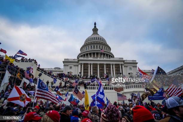 """Trump supporters near the US Capitol following a """"Stop the Steal"""" rally on January 06, 2021 in Washington, DC. The protesters stormed the..."""