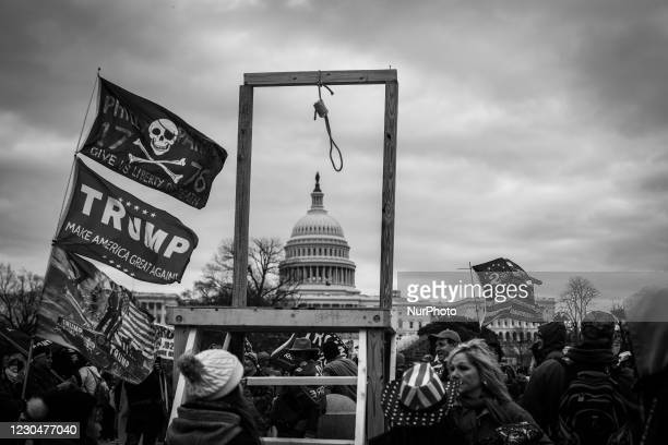Image was converted to black and white) Trump supporters near the U.S Capitol, on January 06, 2021 in Washington, DC. The protesters stormed the...