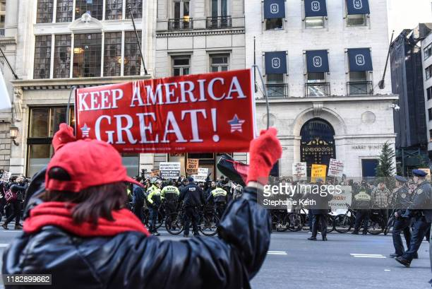 Trump supporters react to protesters from various antifascist groups on November 16 2019 in New York City Two members of the Proud Boys were recently...