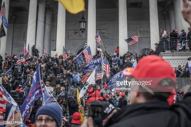 Trump supporters take the steps on the east side of the US Capitol building on January 06, 2021 in Washington, DC. The protesters stormed the...