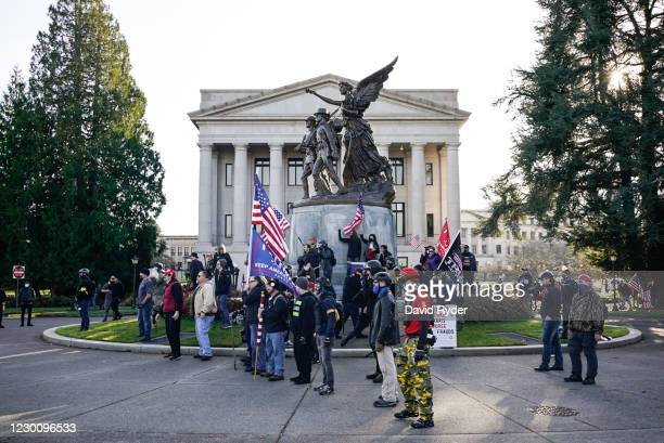 Trump supporters taunt counter-protesters during political clashes on December 12, 2020 in Olympia, Washington. Far-right and far-left groups squared...