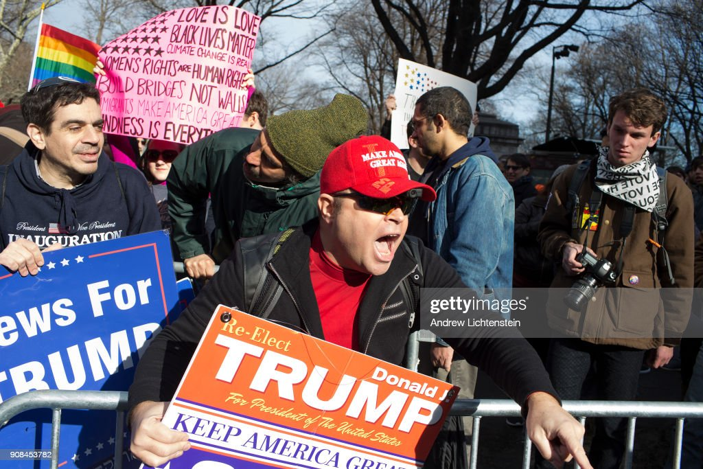 Trump supporters taunt marchers during New York's second annual Women's March on January 20, 2018 in midtown Manhattan.