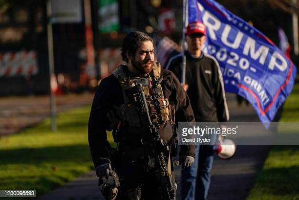 Trump supporters watch counter-protesters during a rally on December 12, 2020 in Olympia, Washington. Far-right and far-left groups squared off near...