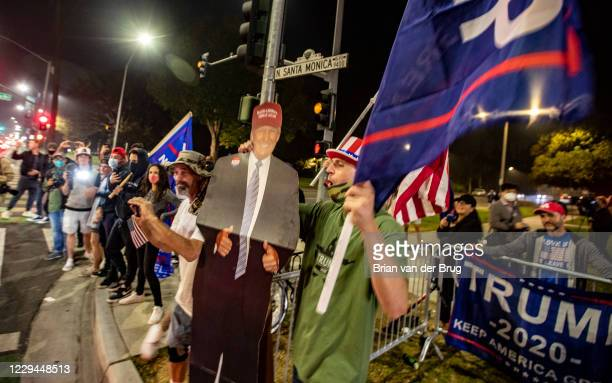 Trump supporters wave flags and cheer as they gather on Santa Monica Blvd. At Beverly Dr. On Tuesday, Nov. 3, 2020 in Beverly Hills, CA.