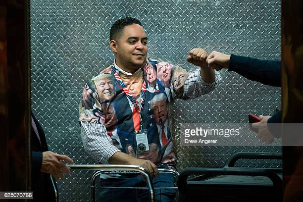 Trump Tower employee wearing a Donald Trump tshirt gives a fist bump in the service elevator at Trump Tower November 22 2016 in New York City...