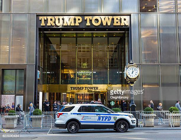 trump tower guarded by nyc police, 5th avenue, manhattan, ny. - trump tower fifth avenue manhattan stock photos and pictures