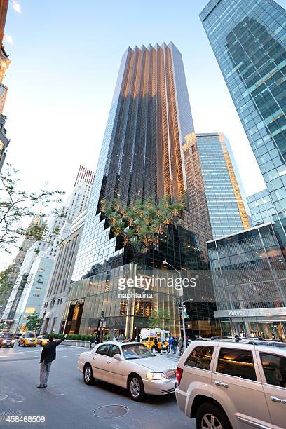 trump tower on fifth avenue and cars - trump tower fifth avenue manhattan stock photos and pictures