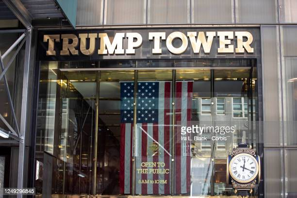 Trump Tower with the American flag hanging from its entrance way. This was part of the Black Womxn's Empowerment March that started at Trump Tower...