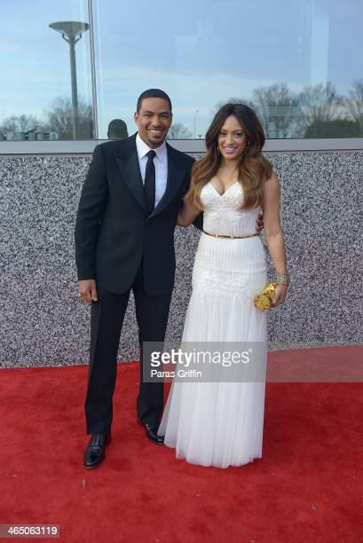 Trumpet Awards hosts Laz Alonso and Melissa De Sousa arrives at the 2014 Trumpet Awards at Cobb Energy Performing Arts Center on January 25 2014 in...