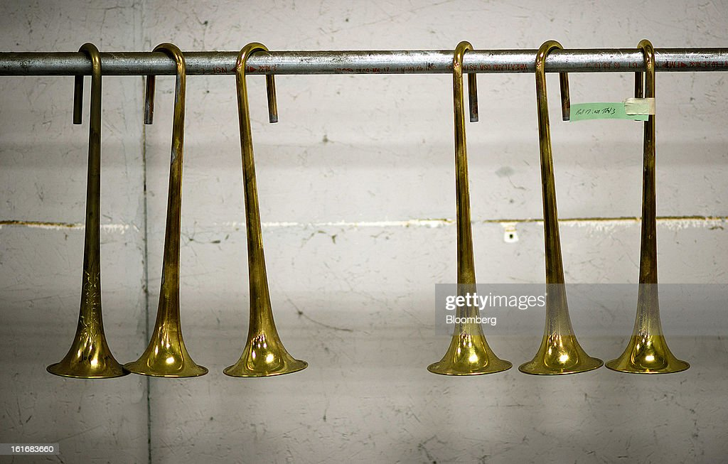 Trumpet bells hang before being be buffed and polished in the manufacturing department of the E.K Blessing Co. in Elkhart, Indiana, U.S., on Thursday, Feb. 7, 2013. The U.S. Federal Reserve is schedule to release industrial productions figures on Feb. 15. Photographer: Ty Wright/Bloomberg via Getty Images