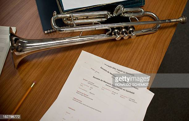 A trumpet is seen on a table before an entrance examination at Ollin Yolitzli mariachi music school at the Garibaldi square in Mexico City on...
