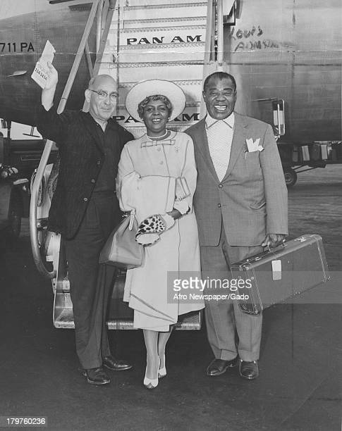 Trumpet King Louis Armstrong and his wife Lucile at International Airport before they boarded Pan American World Airways jet clipper for Rome New...