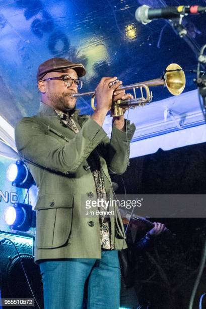 Trumpet player Branden Lewis of Preservation Hall Jazz Band performs live on stage at Ray Benson's 67th birthday party concert benefiting Health...